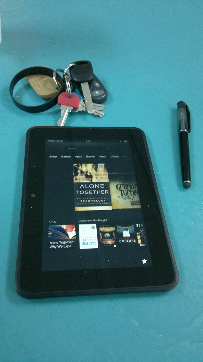 Kindle Fire HD showing cover for Alone Together, w/stylus